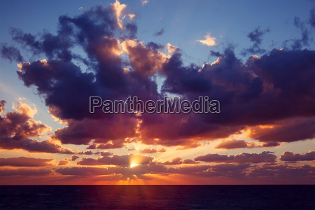 dramatic sunset over sea