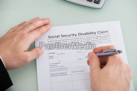 person hand over social security disability