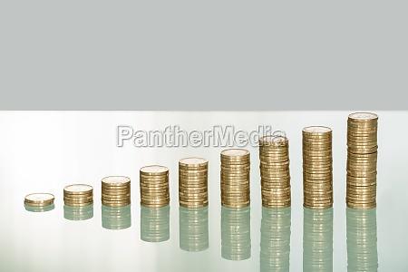 golden coin stack on desk