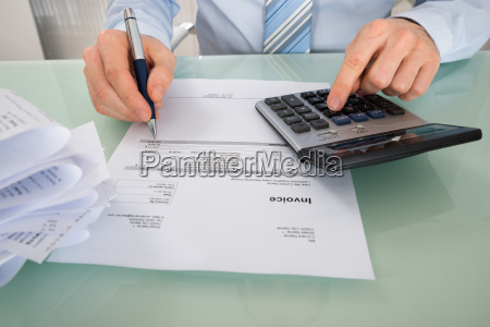 businessman with invoice and calculator