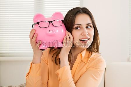 woman holding piggybank