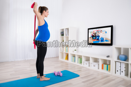 pregnant woman watching television