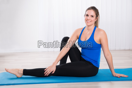 young female on exercise mat