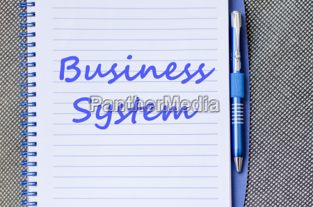 business system write on notebook