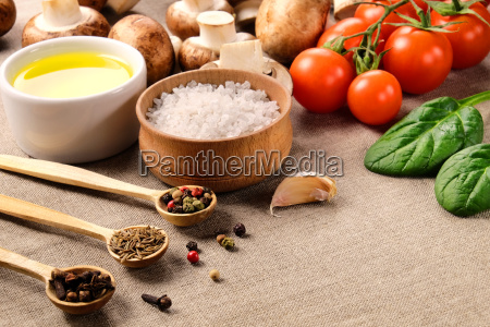 different seasonings with vegetable and mushrooms