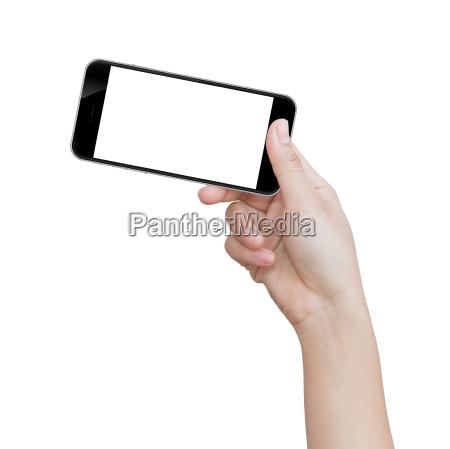 hand holding black phone isolated on