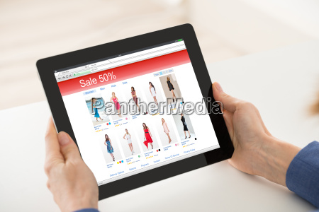 woman hand shopping online on digital