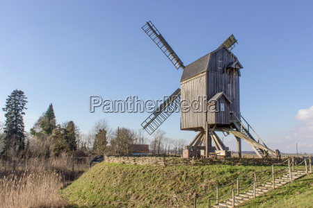 a windmill on a hill