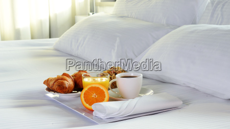 breakfast in bed in hotel room