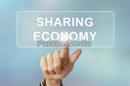 business hand clicking sharing economy button