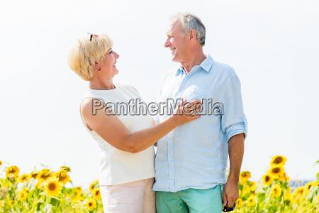 senior man and womana coupleembrace love