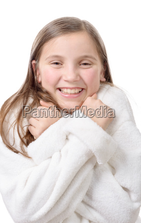 young smiling girl with bathrobe isolated