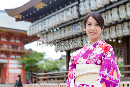 woman wearing the kimono dress at