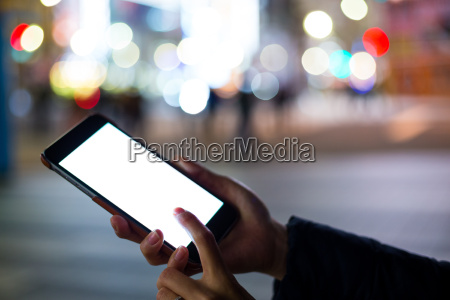woman using cellphone at outdoor with