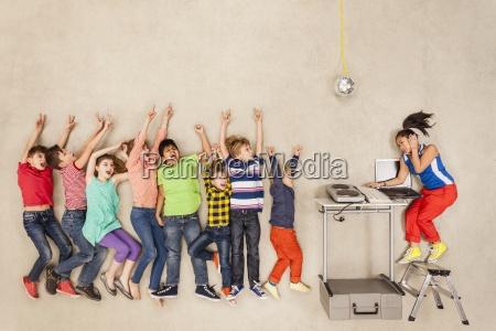 children dancing at school fete