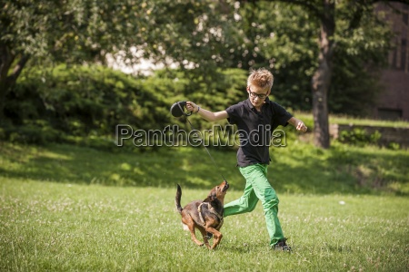 boy playing with his dog on