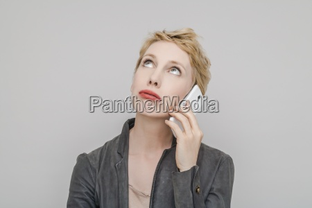 portrait of blond woman with smartphone