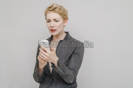 portrait of distraught blond woman looking