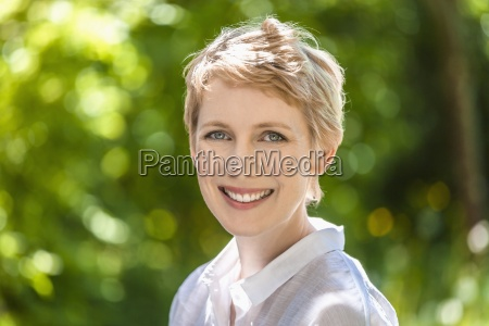 portrait of smiling woman with short