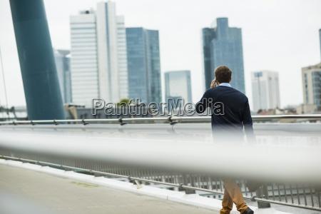 germany hesse frankfurt young businessman walking