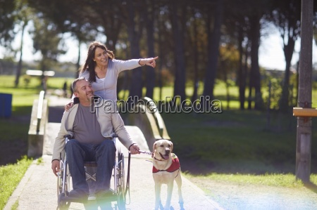 woman with man in wheelchair and