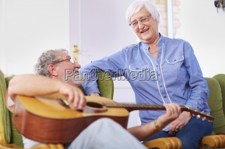 senior man with wife at home