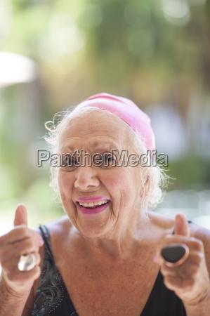 portrait of optimistic senior woman