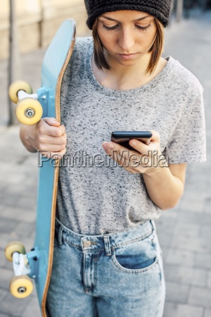 portrait of young female skate boarder