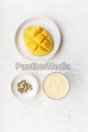 sliced mango cardamom capsules and a