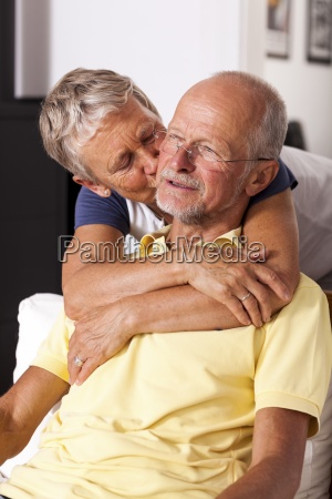 senior woman hugging and kissing her