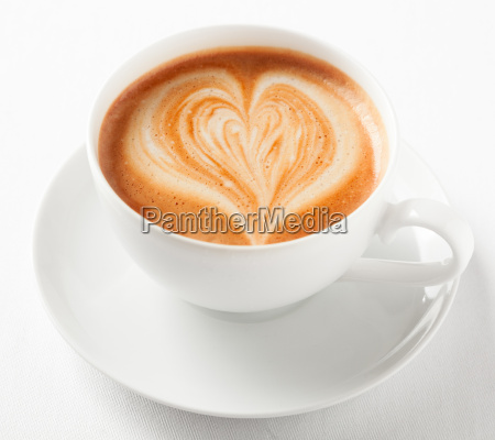 cup of art cappuccino with a