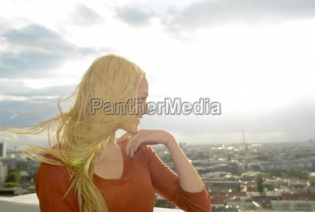 germany berlin young woman with blowing