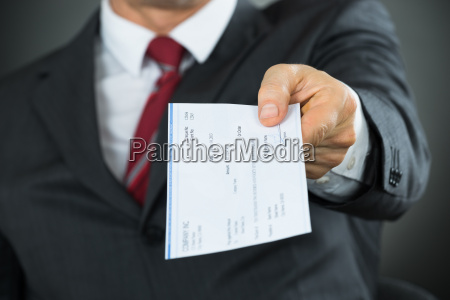 close up of businessman hands giving