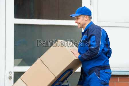 delivery man carrying boxes on a