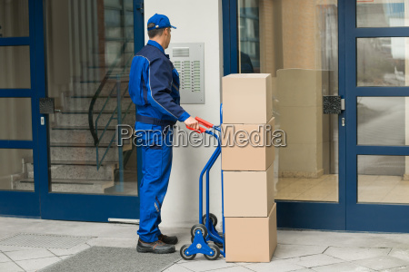 delivery man with trolley using security