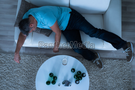 man taking a nap on sofa