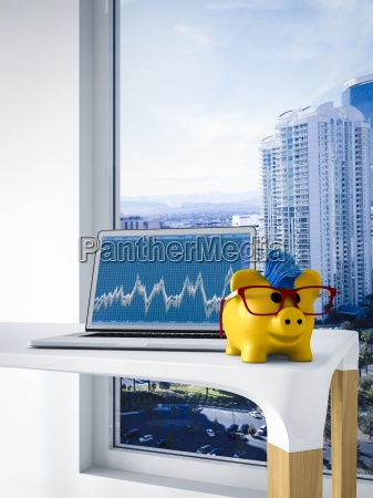 happy piggy bank in front of