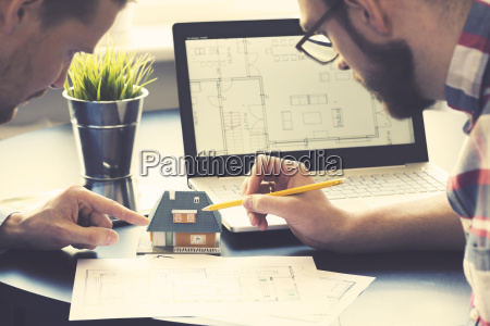 architect showing new family house model
