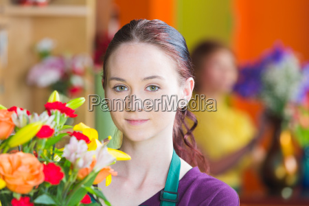 pretty young woman in flower shop