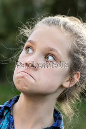 a young girl making funny faces