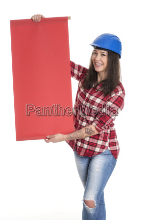 female artisan holds up a poster