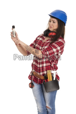 handyman measures the noise level