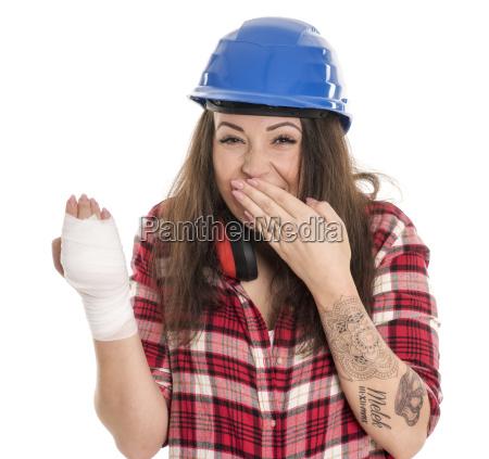 woman with hand bandage celebrates sick