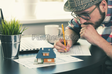 architect construction engineer working on new