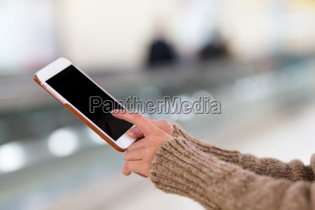 woman use of phone in train