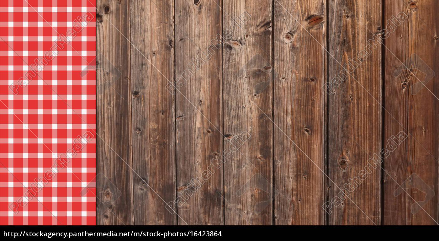 holz hintergrund mit tischdecke rot wei lizenzfreies foto 16423864 bildagentur panthermedia. Black Bedroom Furniture Sets. Home Design Ideas