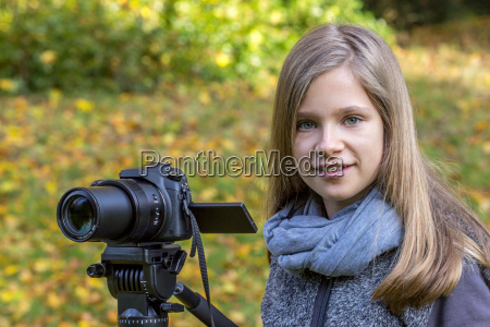 young girl with a camera on