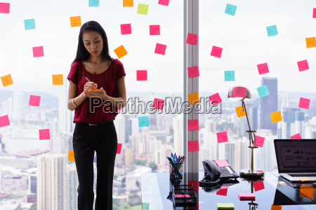 chaotic office with secretary writing sticky