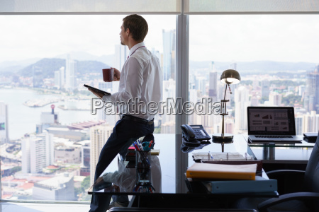 business man reading news press review