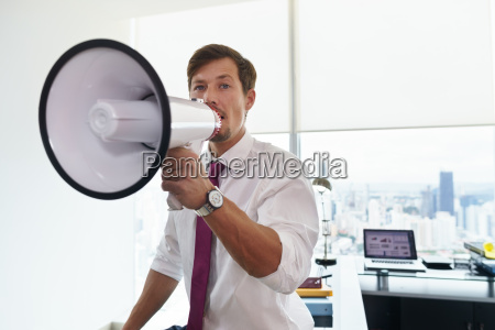 business man with megaphone doing announcement